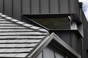 Kingsford project: Paragon 90 degree corner custom shape window in Monument Matt
