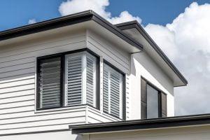 Ascend40 90 degree corner join window and Paragon louvre window in Black Matt