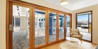 Natura timber bi-fold door and louvre window
