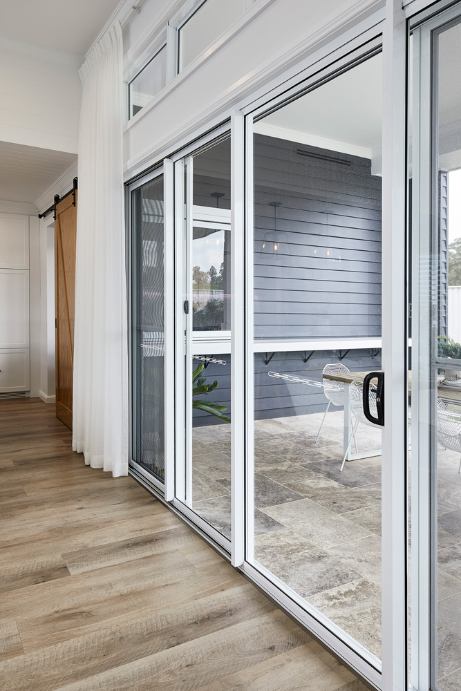 Horizon stacking door and stacking screens in Pearl White