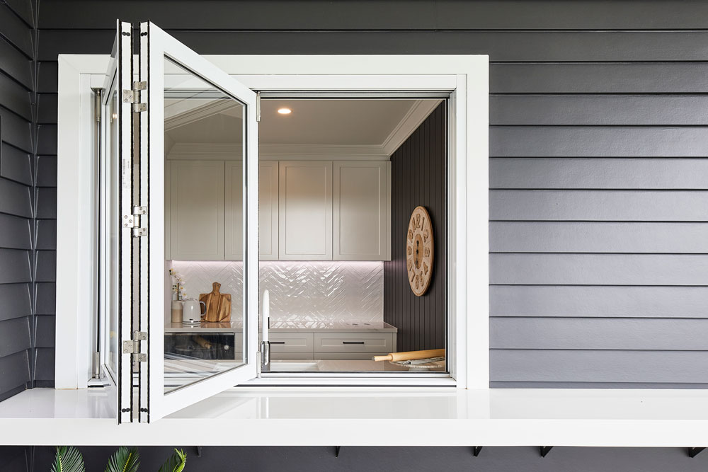 Paragon bi-fold window with sill in Pearl White