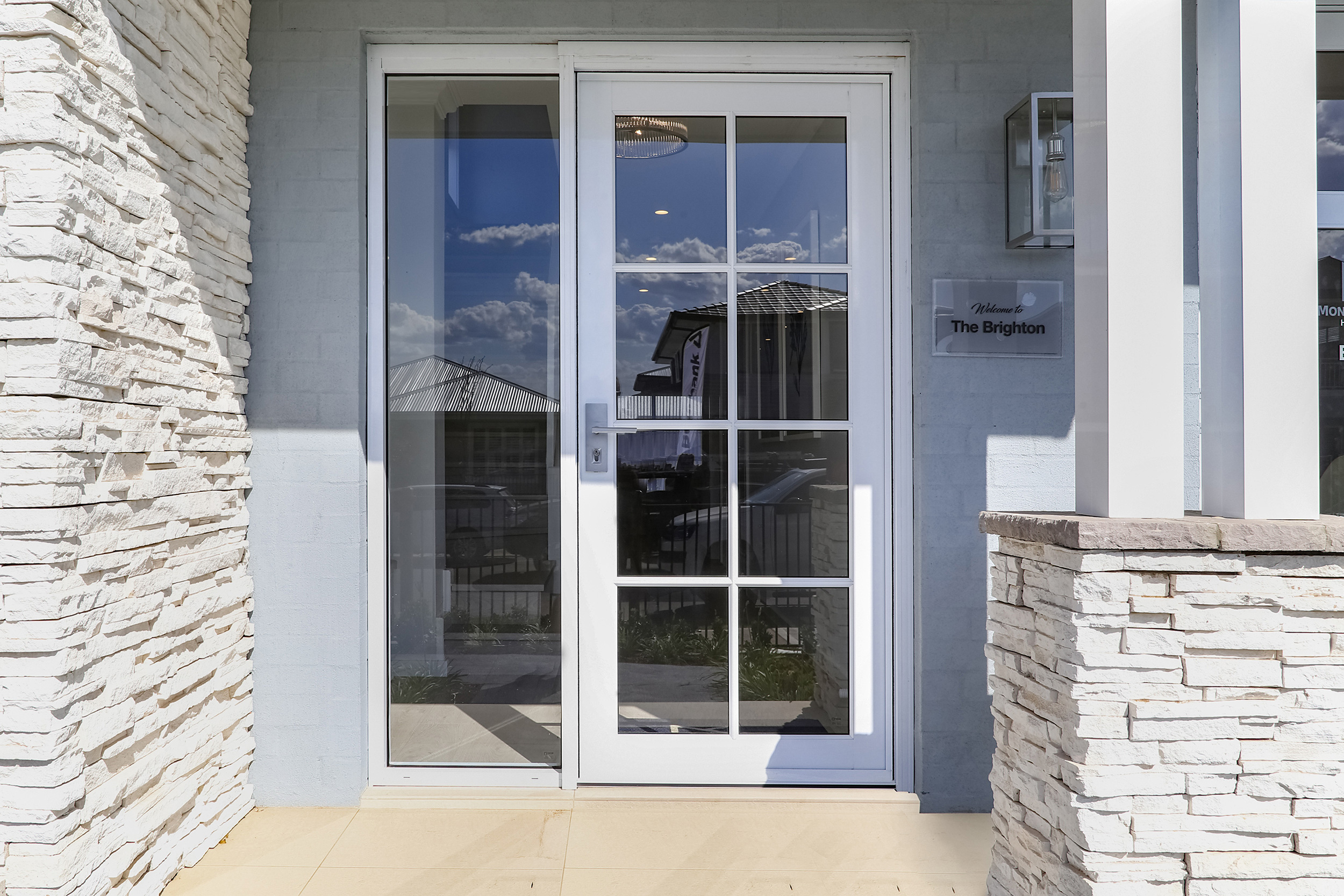 Paragon entry door with glazing bars and sidelight in Pearl White