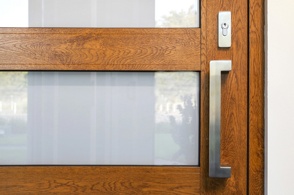 Atrium entry door and stainless steel Verta pull hardware