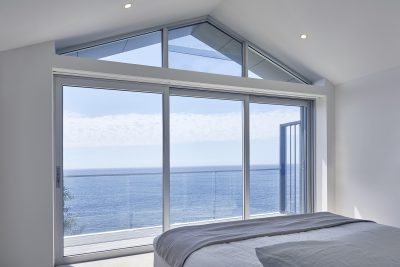 Bondi project: Paragon stacking door and rake window in clear anodised finish