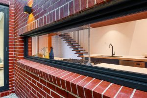 Paragon sashless window in Black Matt