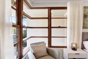 Natura timber double hung window and 90 degree corner join window