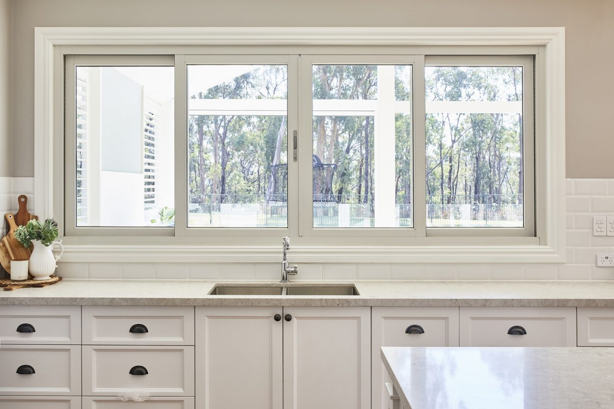 Paragon sliding window kitchen servery with silver hardware, Yellow Rock project