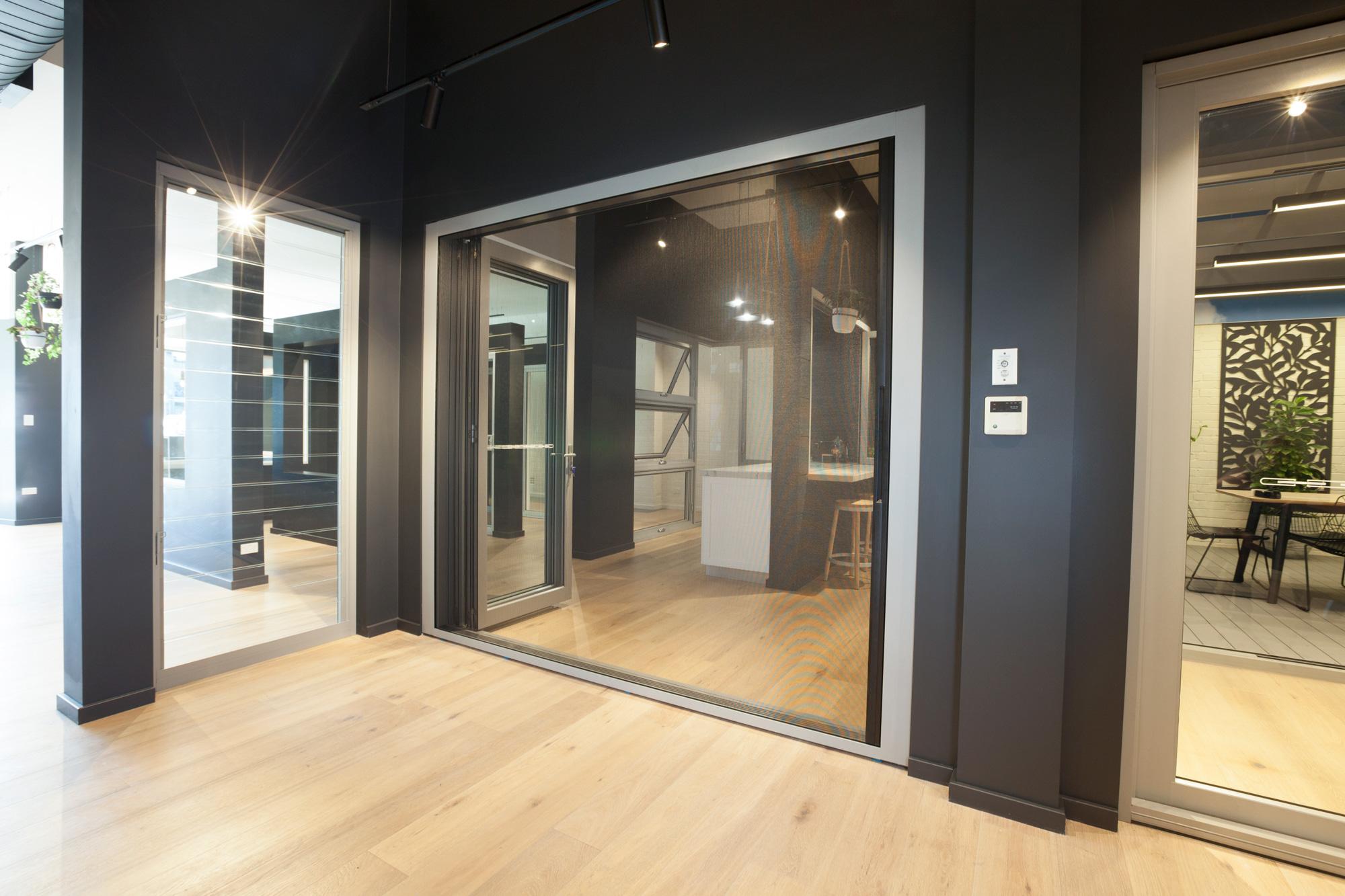 Paragon bi-fold door in Precious Silver with Centor retractable screen, Wideline Rosebery Showroom