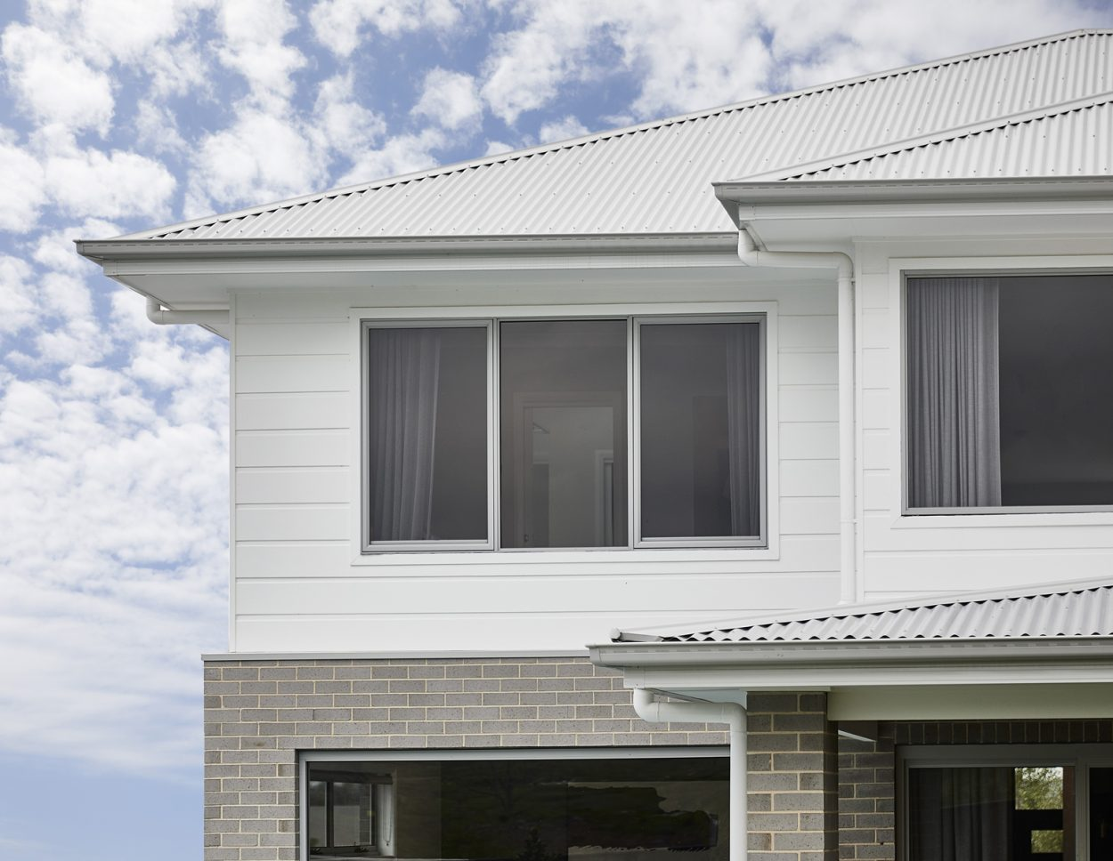 2nd storey home in clad finish with Horizon awning windows in Shale Grey