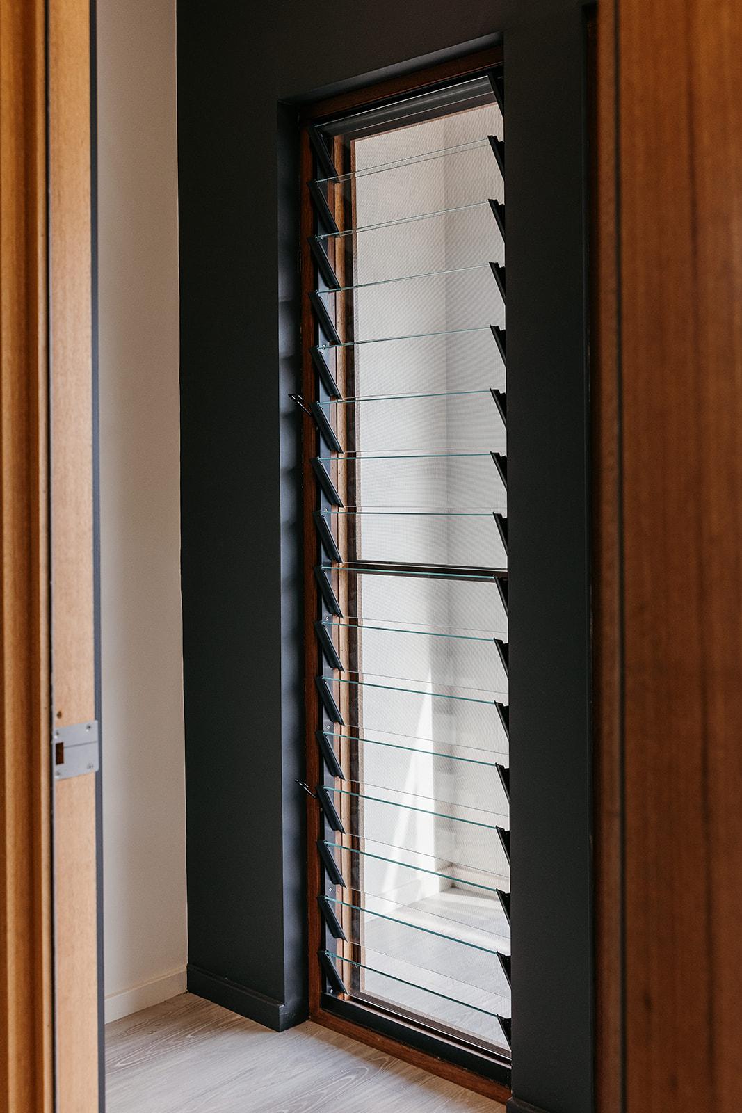 Natura timber louvre window and hardware