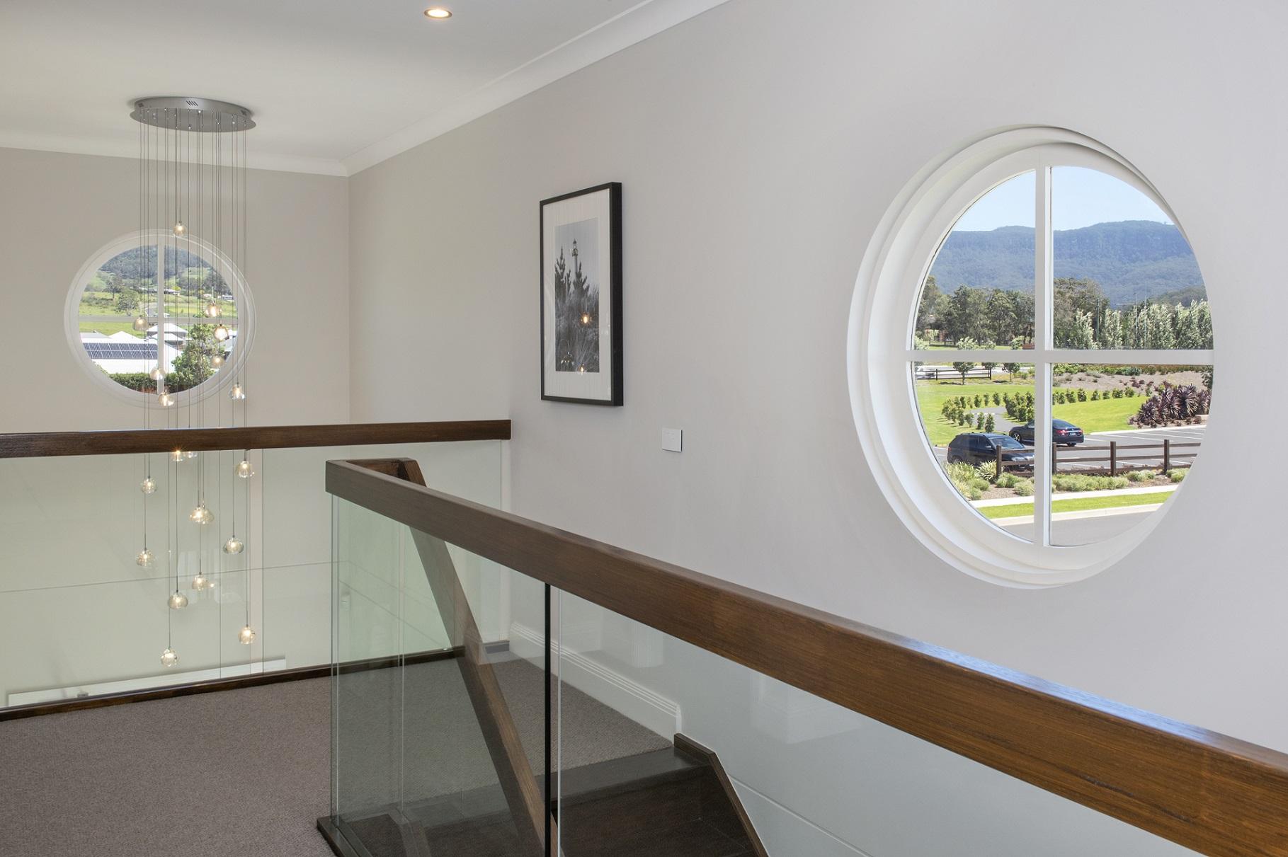 Natura timber round window with glazing bars
